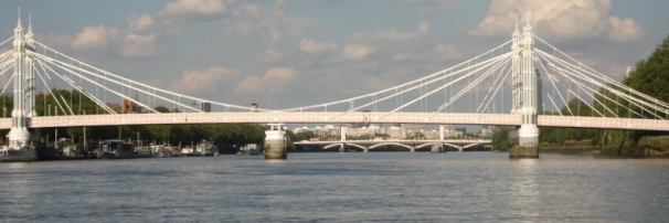 Chelsea Bridge, framed in a span of Albert Bridge.